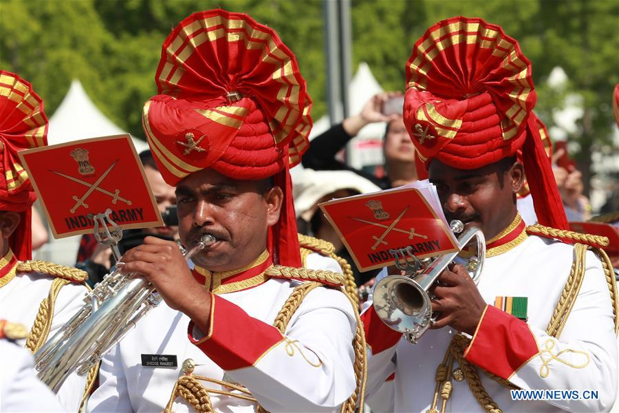 The military band of India takes part in a military band parade held at the Beijing Olympic Park during a military band festival of the Shanghai Cooperation Organization (SCO) in Beijing, capital of China, April 25, 2018. Military bands from eight countries, namely China, Kyrgyzstan, Pakistan, Russia, Tajikistan, Uzbekistan, India and Belarus, took part in the fifth SCO military band festival. (Xinhua/Ju Zhenhua)<br/>