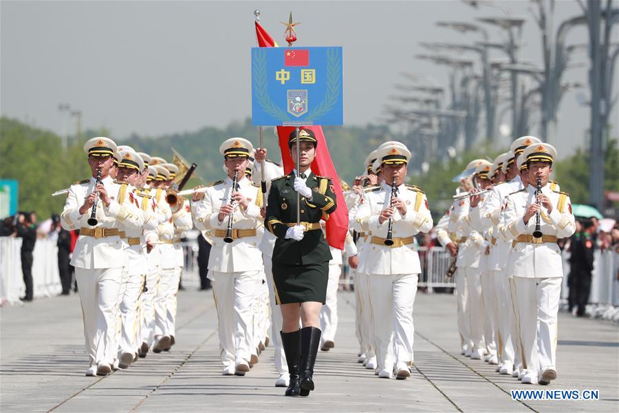 The military band of the Chinese People's Liberation Army (PLA) Navy takes part in a military band parade held at the Beijing Olympic Park during a military band festival of the Shanghai Cooperation Organization (SCO), in Beijing, capital of China, April 25, 2018. Military bands from eight countries, namely China, Kyrgyzstan, Pakistan, Russia, Tajikistan, Uzbekistan, India and Belarus, took part in the fifth SCO military band festival. (Xinhua/Ju Zhenhua)<br/>