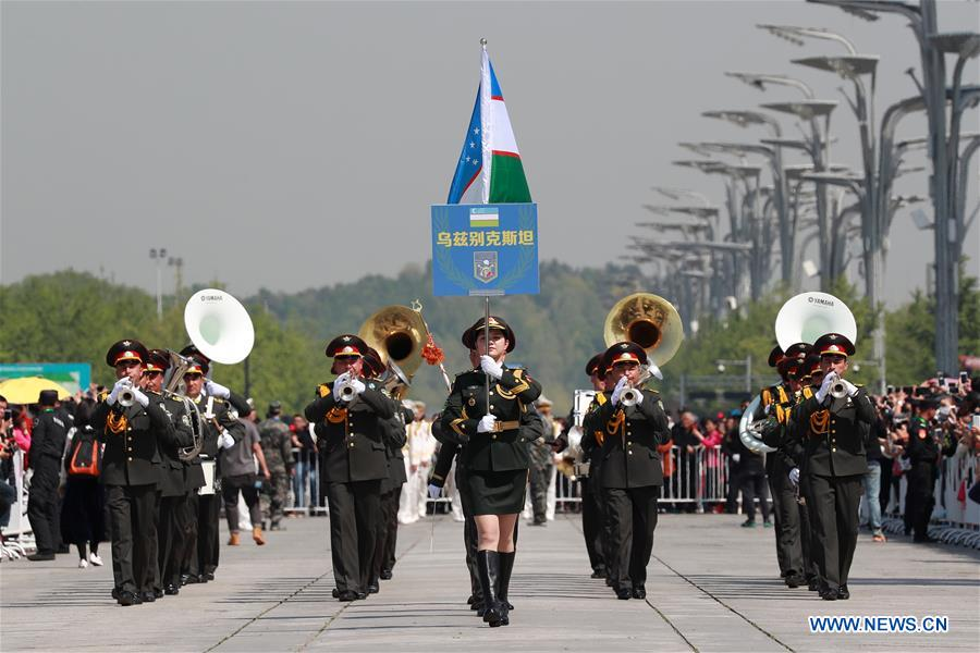 The military band of Uzbekistan takes part in a military band parade held at the Beijing Olympic Park during a military band festival of the Shanghai Cooperation Organization (SCO), in Beijing, capital of China, April 25, 2018. Military bands from eight countries, namely China, Kyrgyzstan, Pakistan, Russia, Tajikistan, Uzbekistan, India and Belarus, took part in the fifth SCO military band festival. (Xinhua/Ju Zhenhua)<br/>