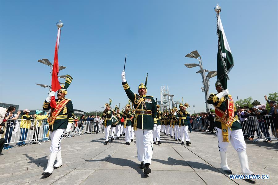 The military band of Pakistan takes part in a military band parade held at the Beijing Olympic Park during a military band festival of the Shanghai Cooperation Organization (SCO), in Beijing, capital of China, April 25, 2018. Military bands from eight countries, namely China, Kyrgyzstan, Pakistan, Russia, Tajikistan, Uzbekistan, India and Belarus, took part in the fifth SCO military band festival. (Xinhua/Ju Zhenhua)<br/>