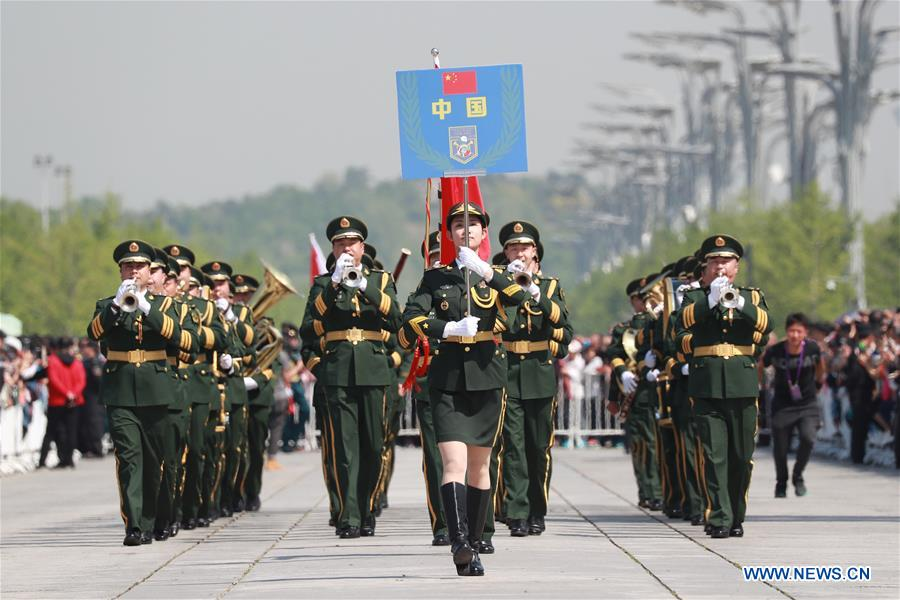 The military band of the Chinese People's Armed Police Force takes part in a military band parade held at the Beijing Olympic Park during a military band festival of the Shanghai Cooperation Organization (SCO), in Beijing, capital of China, April 25, 2018. Military bands from eight countries, namely China, Kyrgyzstan, Pakistan, Russia, Tajikistan, Uzbekistan, India and Belarus, took part in the fifth SCO military band festival. (Xinhua/Ju Zhenhua)<br/>