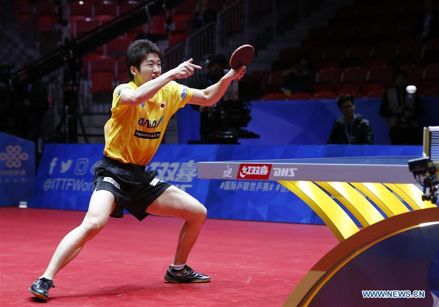 Mizutani Jun of Japan returns to Poh S. F. Ethan of Singapore at the fifth round of Men's group match during the 2018 World Team Table Tennis Championships in Halmstad, Sweden, May 2, 2018. Mizutani Jun won the game with 3-0, and team Japan won the match with 3-0. (Xinhua/Ye Pingfan)<br/>
