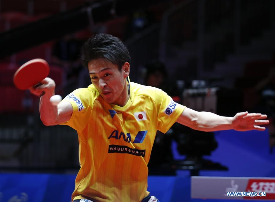 Oshima Yuya of Japan returns to Beh Kun Ting of Singapore at the fifth round of Men's group match during the 2018 World Team Table Tennis Championships in Halmstad, Sweden, May 2, 2018. Oshima Yuya won the game with 3-0, and team Japan won the match with 3-0. (Xinhua/Ye Pingfan)<br/>