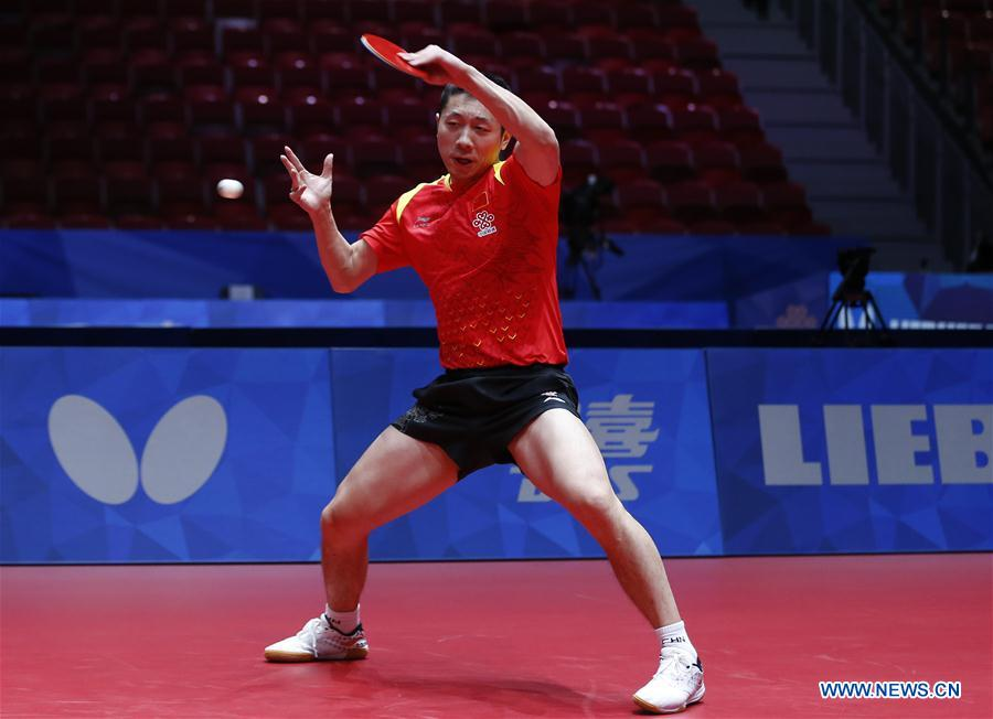 Xu Xin of China returns to Kang Wi Hun of Democratic People's Republic of Korea (DPRK) at the fifth round of Men's group match during the 2018 World Team Table Tennis Championships in Halmstad, Sweden, May 2, 2018. Xu won the game with 3-0, and team China won the match with 3-0. (Xinhua/Ye Pingfan)<br/>