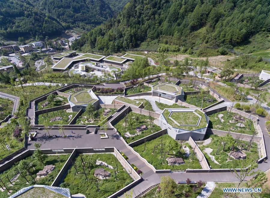 Aerial photo taken on May 16, 2018 shows the Shenshuping giant panda protection base of Wolong National Nature Reserve in Gengda Township, southwest China's Sichuan Province. The Wolong reserve, some 30 kilometers away from the epicenter of the devastating 2008 earthquake, was severely damaged in the disaster. As a result, some pandas inhabiting the reserve had to be relocated in zoos after the quake. As years passed, Wolong still remains as a suitable habitat for giant panda. Sponsored by the government of the Hong Kong Special Administrative Region, the Shenshuping base covering an area of about 150 hectares opened on May 11, 2016. It is now home to more than 50 giant pandas. (Xinhua/Jiang Hongjing)<br/>