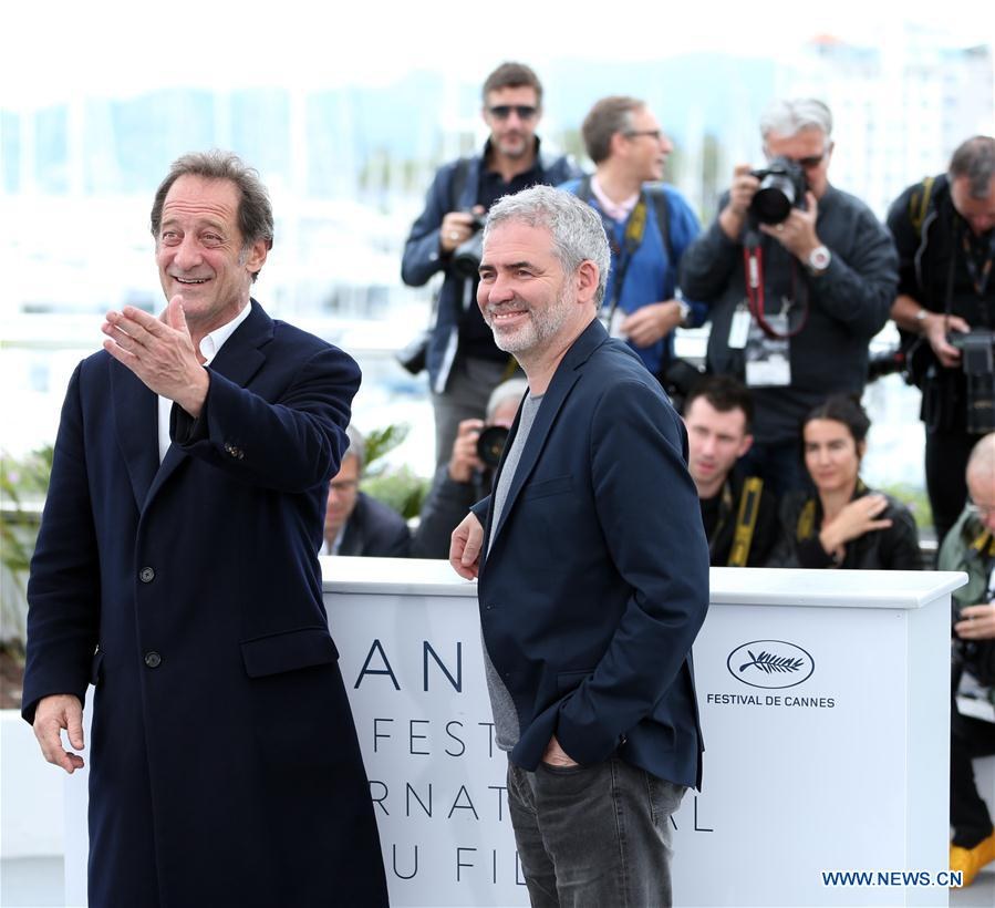 """Actor Vincent Lindon (L) and director Stephane Brize of the film """"In War (En Guerre)"""" pose during a photocall of the 71st Cannes International Film Festival in Cannes, France on May 16, 2018. The 71st Cannes International Film Festival is held from May 8 to May 19. (Xinhua/Luo Huanhuan)"""