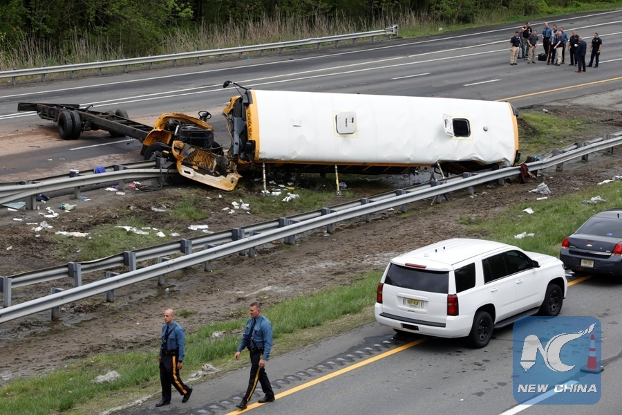 2 killed, dozens others injured in school bus crash with
