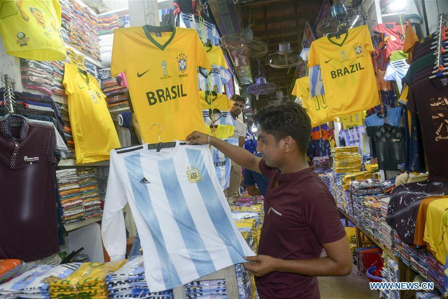 Customized shirts of FIFA World Cup sold at market in Dhaka