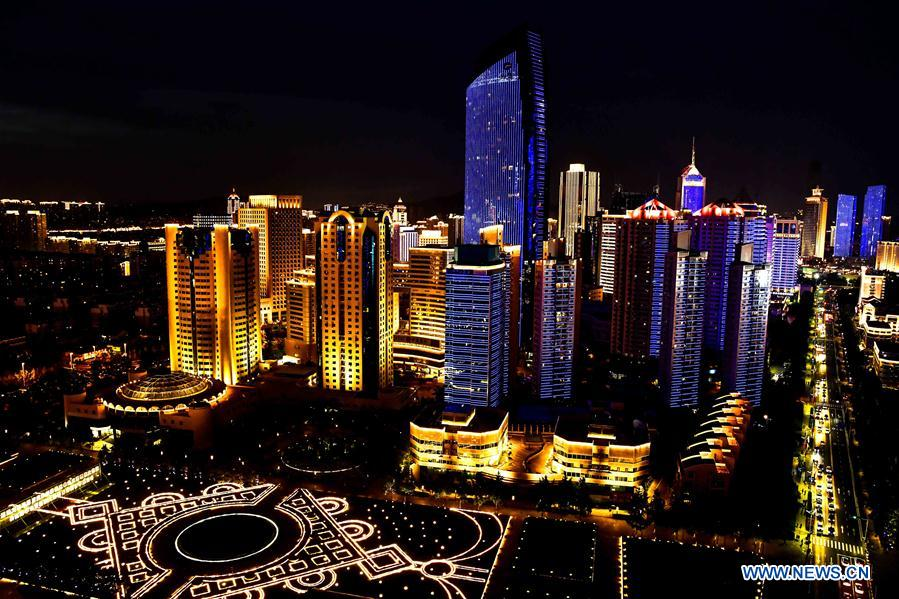 Photo taken on June 2, 2018 shows the night view near Wusi Square in Qingdao, east China's Shandong Province. The 18th Shanghai Cooperation Organization (SCO) Summit is scheduled for June 9 to 10 in Qingdao. (Xinhua/Guo Xulei)<br/>