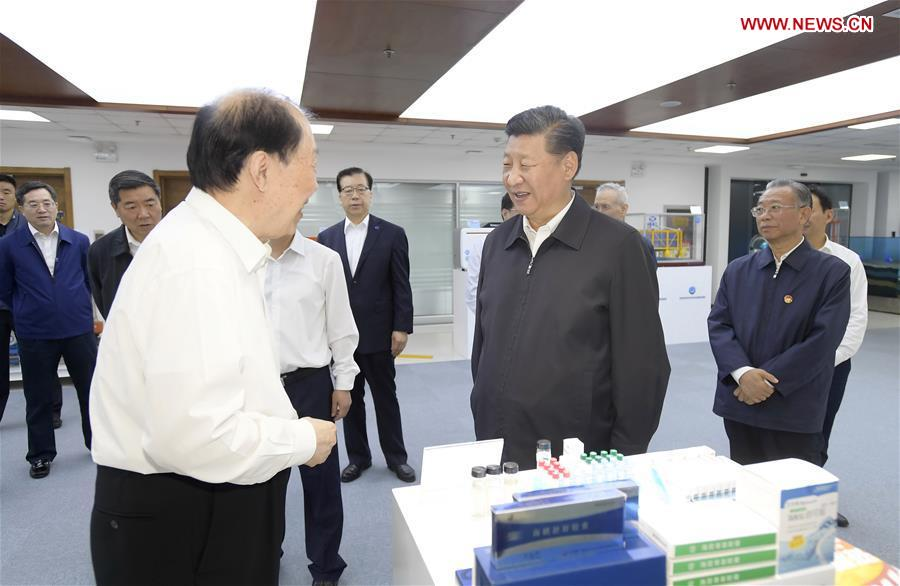 Chinese President Xi Jinping, also general secretary of the Communist Party of China Central Committee and chairman of the Central Military Commission, talks with academician of Chinese Academy of Engineering Guan Huashi at Pilot National Laboratory for Marine Science and Technology during an inspection tour in Qingdao, east China's Shandong Province, June 12, 2018. (Xinhua/Li Xueren)<br/>