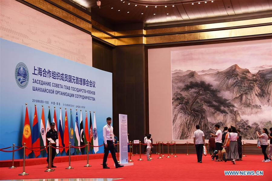 Visitors take a tour inside the Olympic sailing center in Qingdao of east China's Shandong Province, July 1, 2018. The center, used as the conference hall during the 18th Shanghai Cooperation Organization (SCO) summit, after a brief remodification, was opened to the public from this Sunday. (Xinhua/Li Ziheng)<br/>