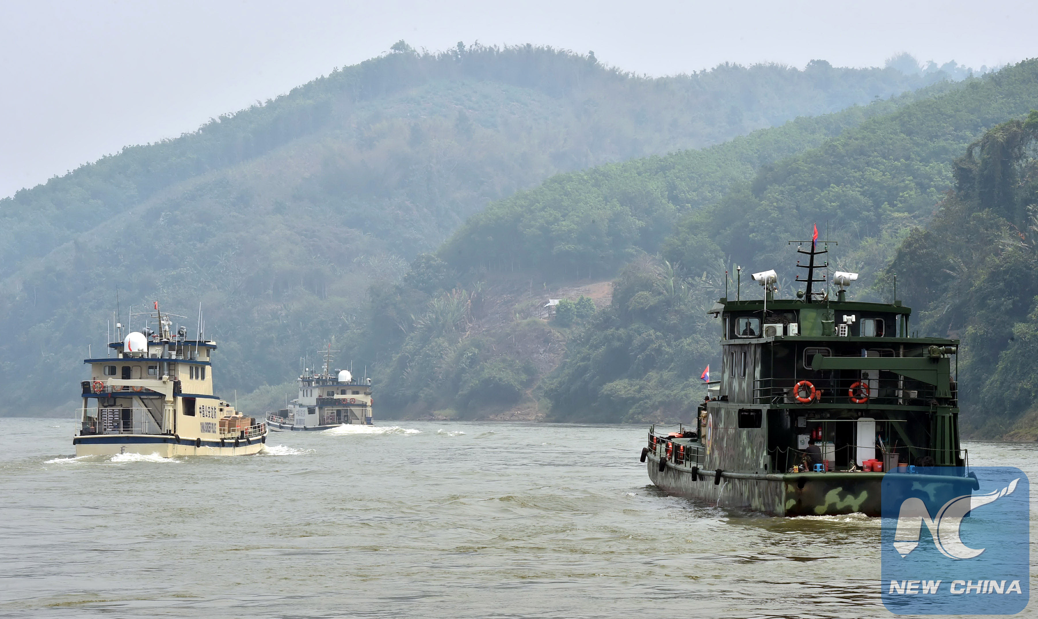 Joint patrol vessels with law enforcement personnel from China, Thailand, Laos and Myanmar, sail on the Lancang-Mekong River, March 17, 2015. (Xinhua/Chen Haining)