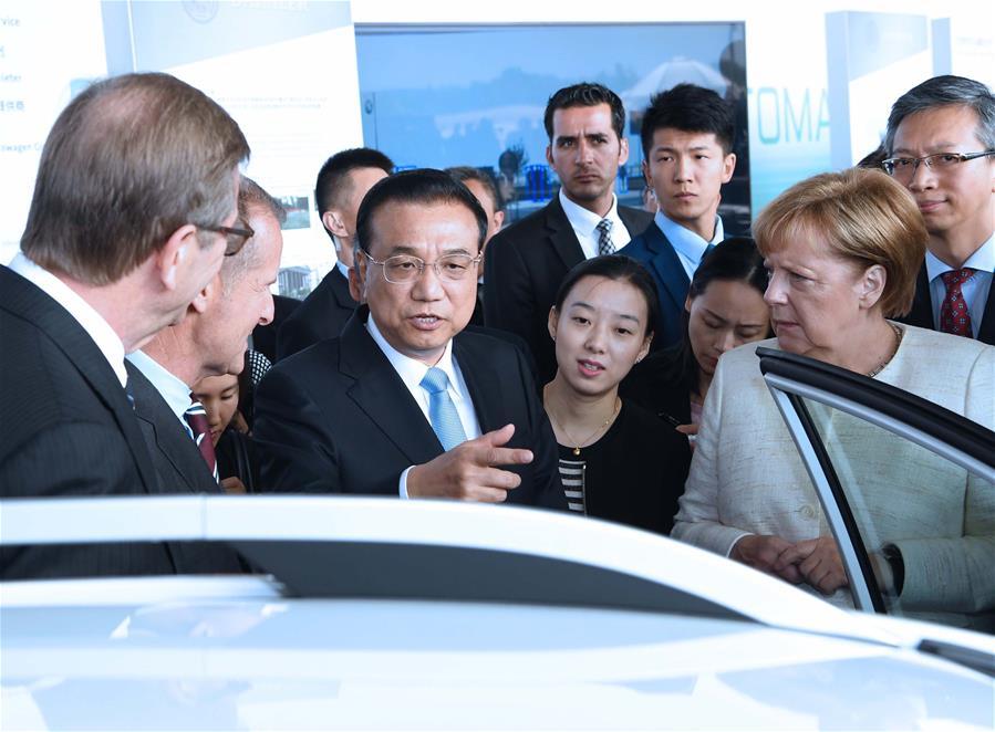 GERMANY-BERLIN-CHINA-LI KEQIANG-MERKEL-AUTOPILOT COOPERATION EXHIBITION