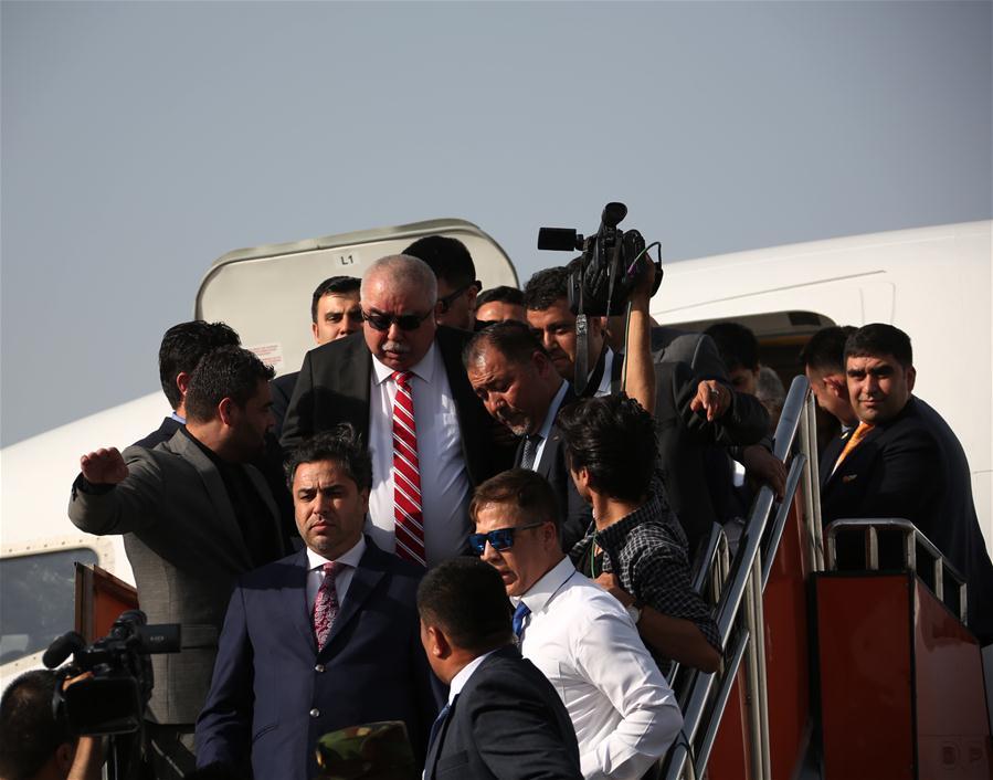 Afghan VP Dostum returns home after medical treatment in