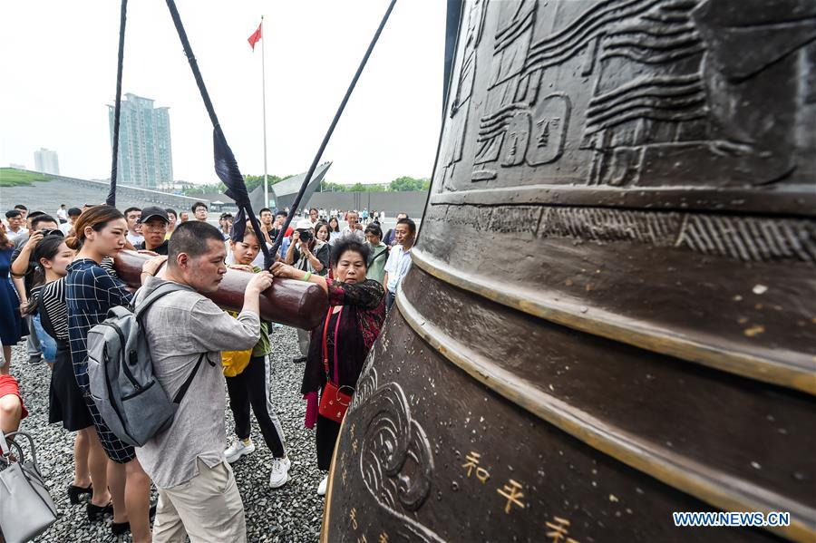 People ring the bell of peace during a commemorative activity marking the 73rd anniversary of the victory in the Chinese People's War of Resistance Against Japanese Aggression and the World Anti-Fascist War at the Memorial Hall of the Victims in Nanjing Massacre by Japanese Invaders in Nanjing, east China's Jiangsu Province, Sept. 3, 2018. (Xinhua/Li Bo)