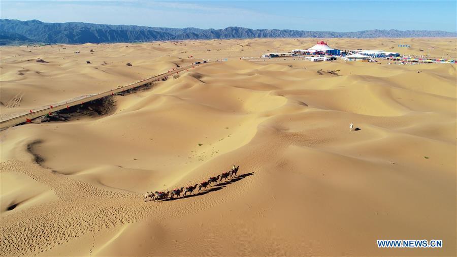 Aerial photo taken on Sept. 7, 2018 shows the Tengger Desert in Zhongwei City, northwest China's Ningxia Hui Autonomous Region. (Xinhua/Wang Peng)<br/>