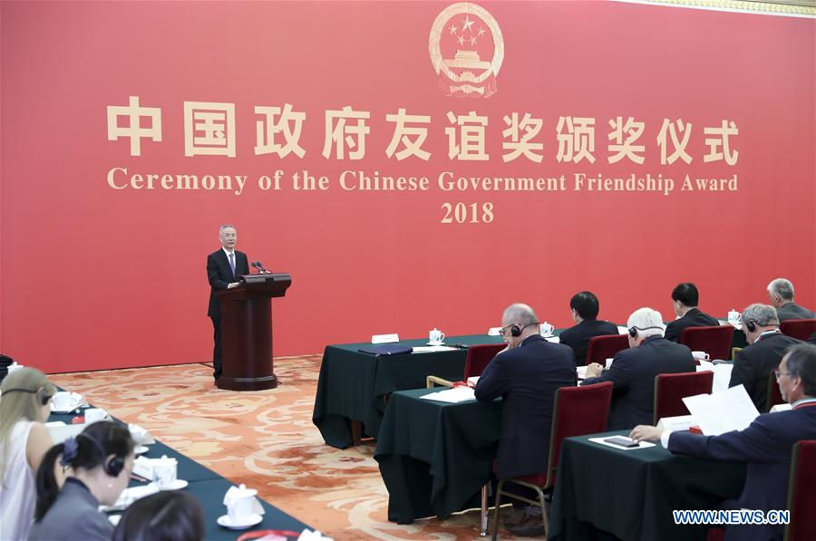 China confers Friendship Award to foreign experts - Xinhua | English