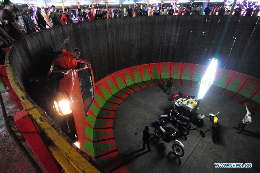 Acrobatic riders steer motorcycles on