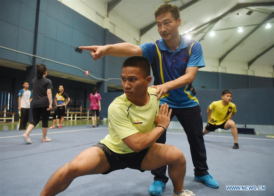 Feature: Chinese Wushu coach helps train Brunei's martial