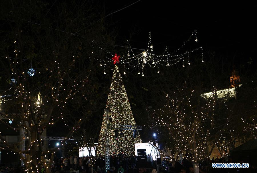 Illuminated Christmas Tree Seen During Lighting Ceremony In