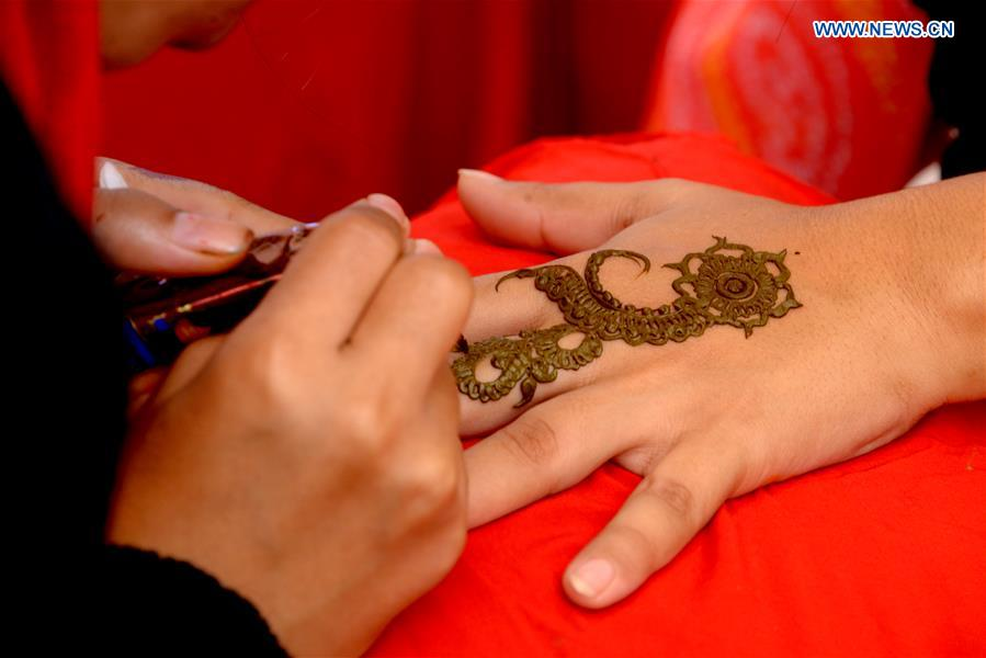 Women Have Henna Painted On Hands At Wedding Fair In Dhaka
