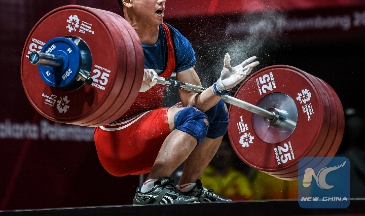 7d54c993abb068 Trinh Van Vinh of Vietnam competes during the men s weightlifting 62kg  event at the 18th Asian Games in Jakarta