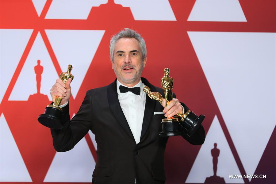 Alfonso Cuaron wins Best Director award for