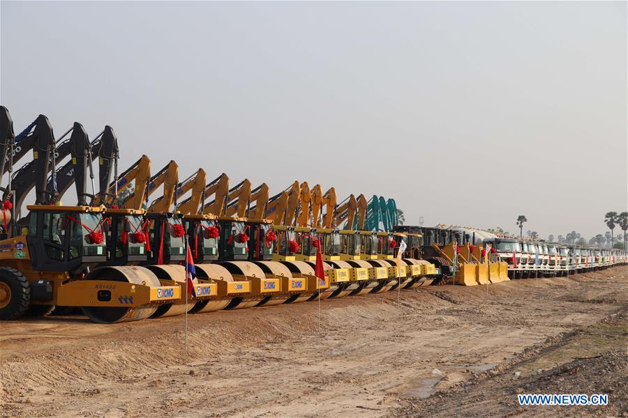 Machines line up during a groundbreaking ceremony for the construction of a 190-km expressway stretching from capital Phnom Penh to the deep-sea port province of Preah Sihanouk in Kampong Speu, Cambodia, March 22, 2019. Image: Xinhua/Mao Pengfei