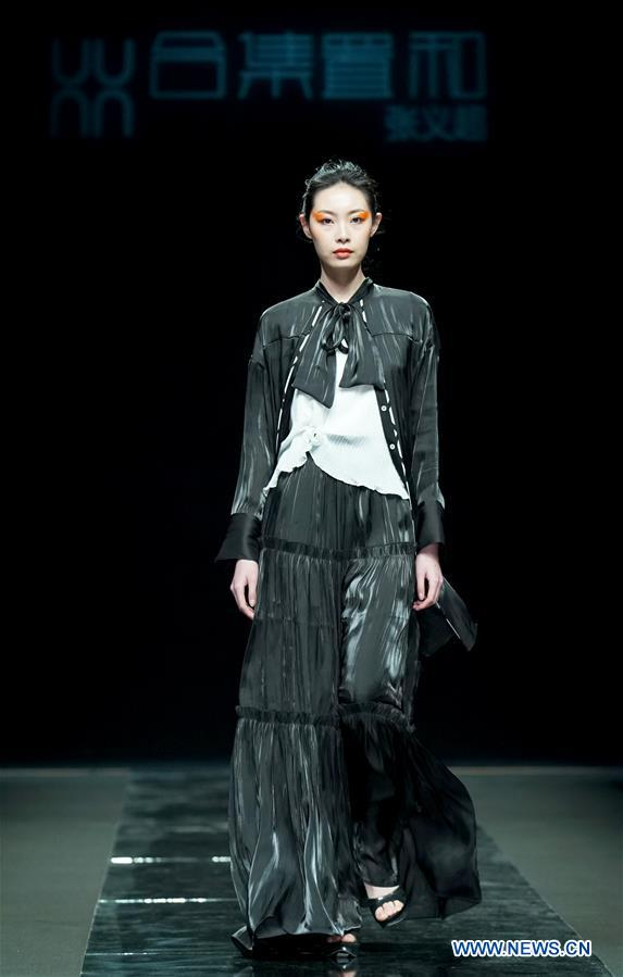 Models present creations during China Fashion Week in