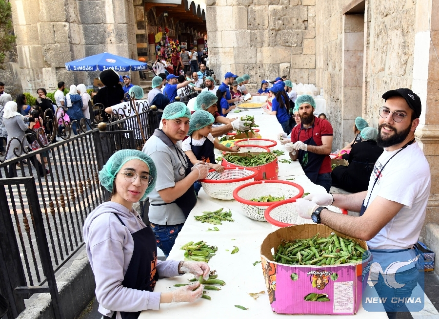 Feature: Charity kitchens help poor people in Syria's Damascus during Ramadan