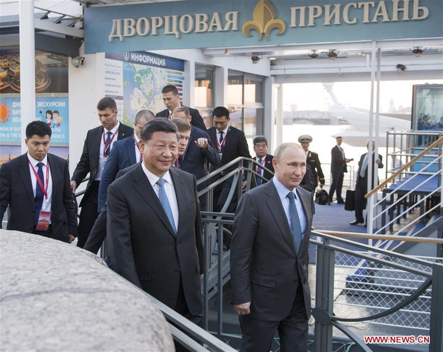 RUSSIA-ST. PETERSBURG-XI JINPING-PUTIN-MEETING