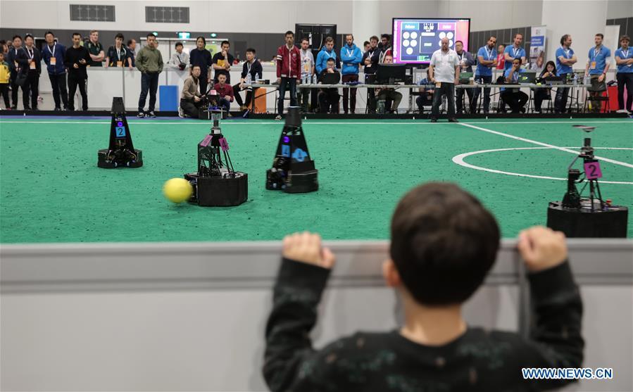 Feature: China's Zhejiang University wins int'l robot soccer