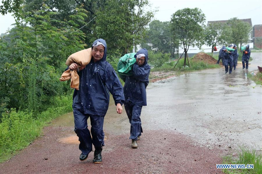 Image result for Flood rescue and relief work carried out in China's Jiangxi