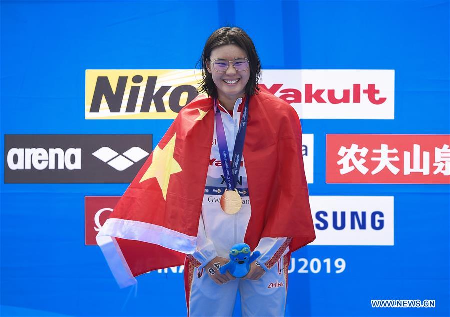 Xin Xin wins 1st gold for China in open water swimming at FINA