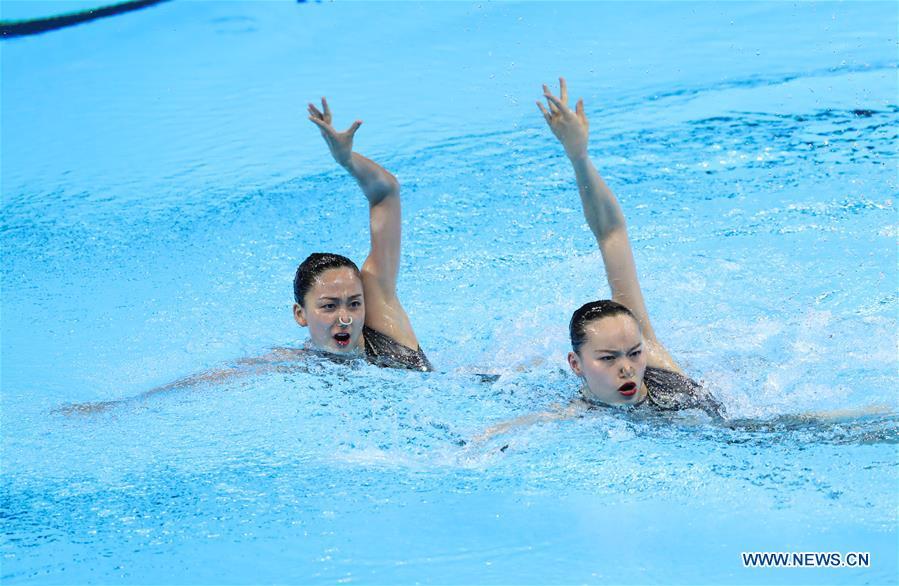 Sun Wenyan/Huang Xuechen win silver in artistic swimming of