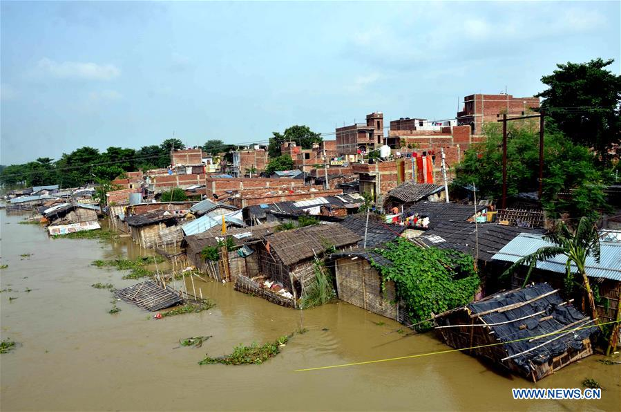 Spotlight: Death toll soars as flood situation remains grim in India - Xinhua | English.news.cn