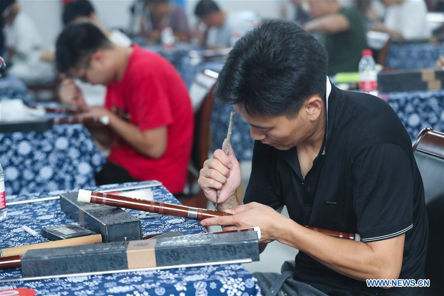 Craftspeople participate in bamboo flute making contest in