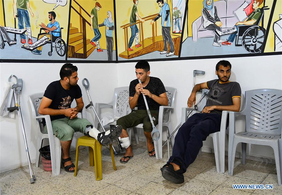 MIDEAST-GAZA-DISABLED MAN-CRUTCH-FLUTE