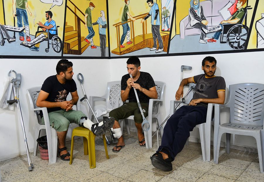 Gaza's disabled youth turns crutch into flute to express peace hope - Xinhua   English.news.cn