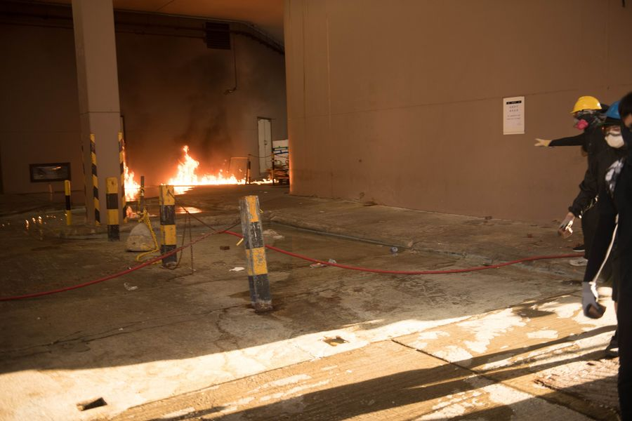Radical protesters set fires, block roads in Hong Kong's Tuen Mun - Xinhua | English.news.cn