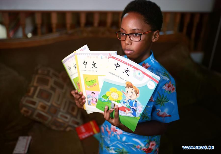 U.S.-CHICAGO-AFRICAN AMERICAN BOY-CHINESE CULTURE-LEARNING