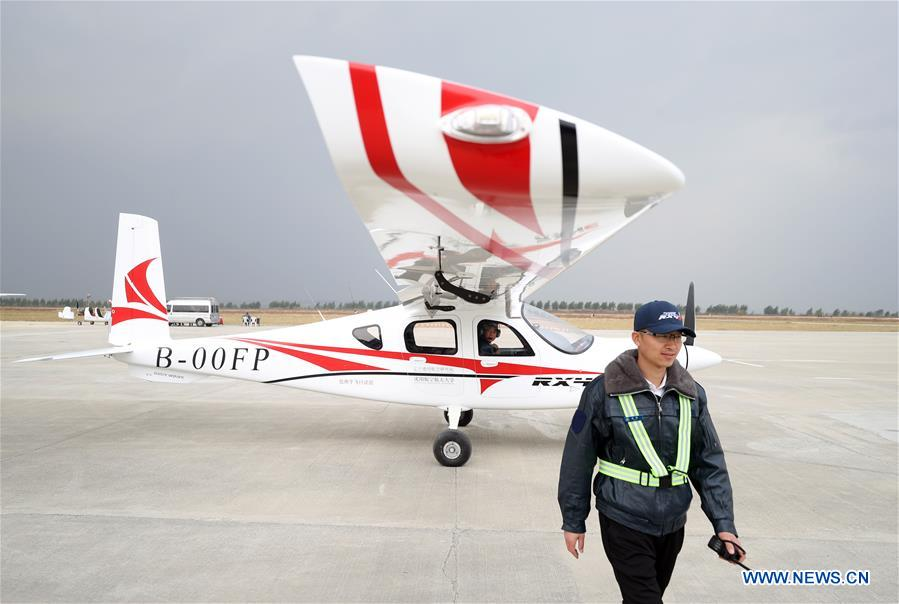 China's first four-seater electric aircraft makes maiden flight ile ilgili görsel sonucu