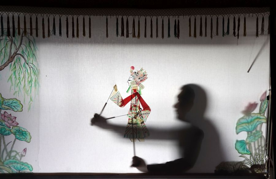 Villager's devotion to traditional Chinese shadow puppet - Xinhua | English.news.cn