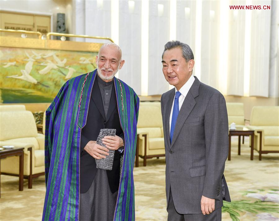 CHINA-BEIJING-WANG YI-AFGHANISTAN-FORMER PRESIDENT-KARZAI-MEETING (CN)