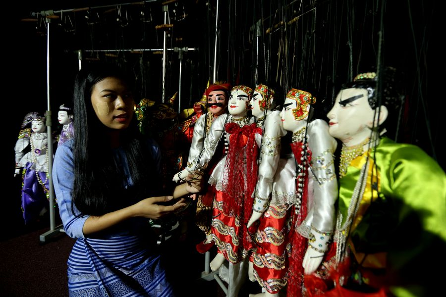 Myanmar young female puppeteer displays awe-inspiring passion for marionettes        - Xinhua | English.news.cn