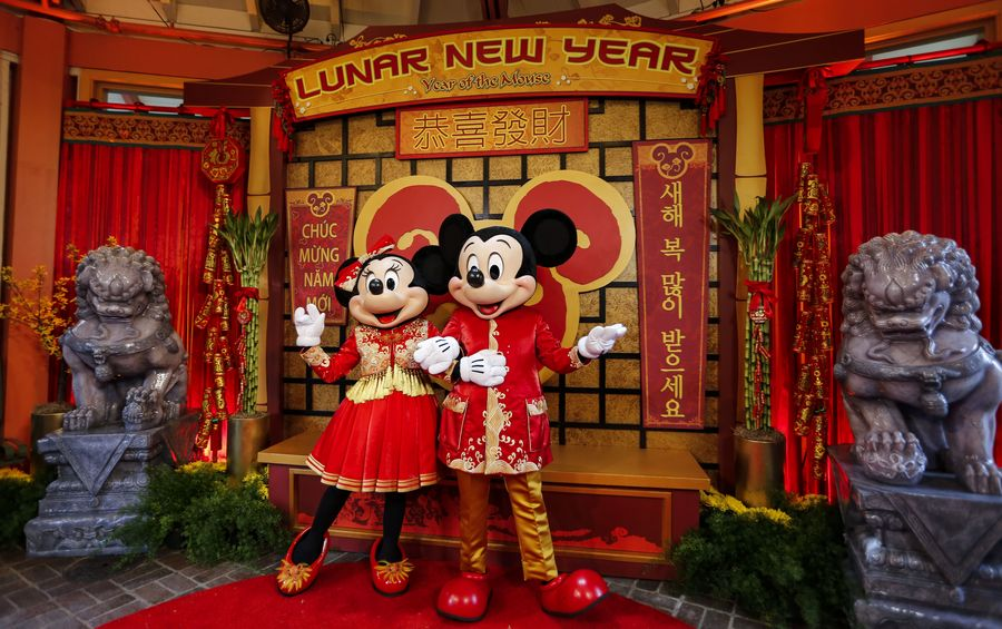 Feature: Renowned fashion designer brings touch of Chinese New Year festivity to Disney icon - Xinhua | English.news.cn