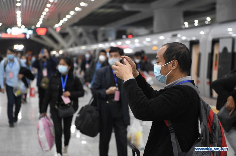 CHINA-GUANGZHOU-MIGRANT WORKERS FROM HUBEI-ARRIVAL (CN)