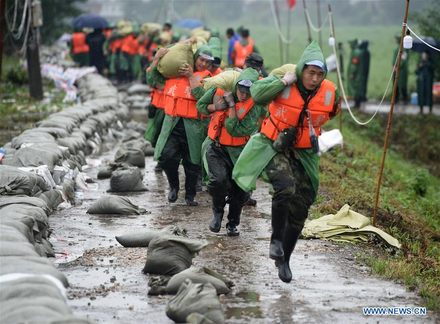Armed Police Officers Reinforce Sanlongwei Section of Levee in Wuhu, E China