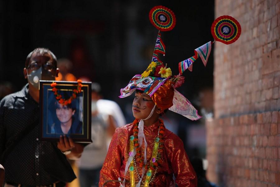 Asia Album: Nepalese celebrate Gaijatra festival to worship departed loved ones amid COVID-19 epidemic  - Xinhua | English.news.cn