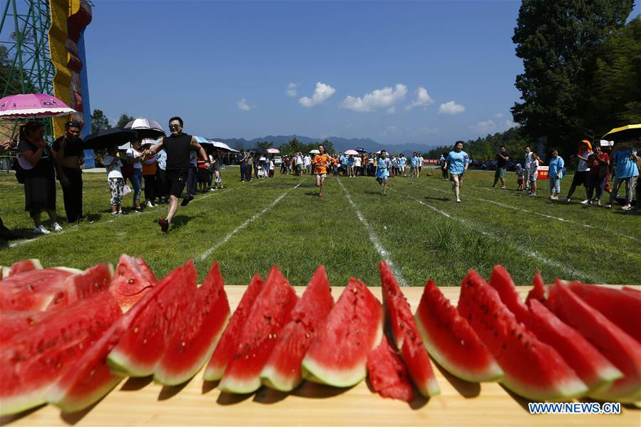 tourists take part in watermelon game in huangshan east china